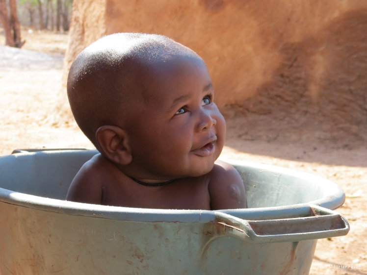 Himba baby boy in bath tub
