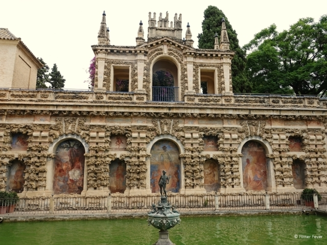 Pond with statue at Real Alcazar Seville Sevilla