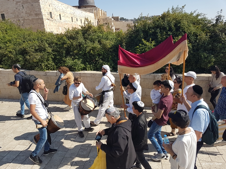 13-year-old boy celebrates his Bar Mitzvah at Dung Gate towards the Western Wall in Jerusalem
