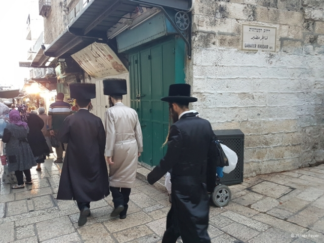 Jewish men on their way to Western Wall with Shabbat