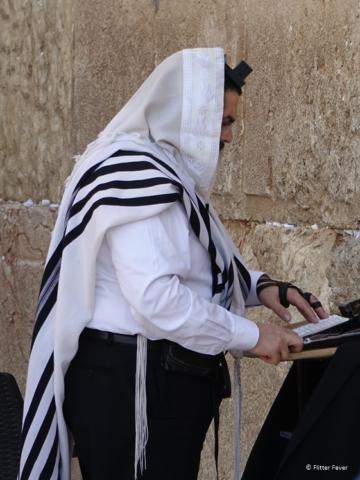 Man praying at the Western Wall in Jerusalem