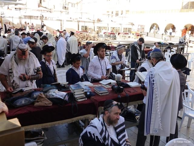 Men and boys praying at the Western Wall Jerusalem