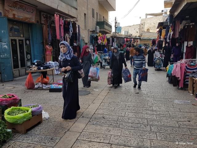Palestinians shopping in Children St Bethlehem