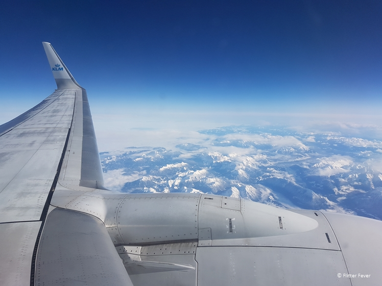 Snow on the mountains while flying from Amsterdam to Naples with KLM