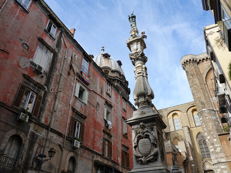 The houses around Obelisco di San Gennaro at Piazza Cardinale Sisto Riario Sforza seem badly maintained Napoli