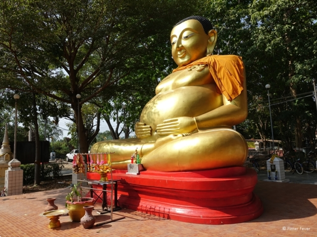 Chinese Golden Buddha with big belly at Wat Bang Nam Phueng Nok on Bang Kachao side view