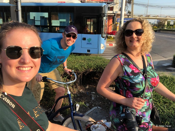 Happy Bicycle People - Tharin, Tom and I waiting for traffic lights on our way to the slum of Bangkok