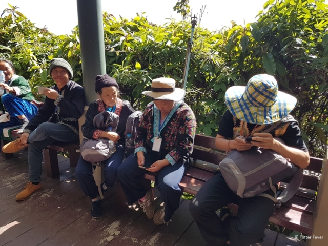 Hmong guides waiting for their next group at Kew Mae Pan Nature Trail