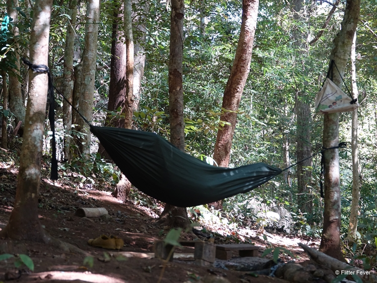 Thai people can sleep anywhere hammock between trees Lod Cave near Pai