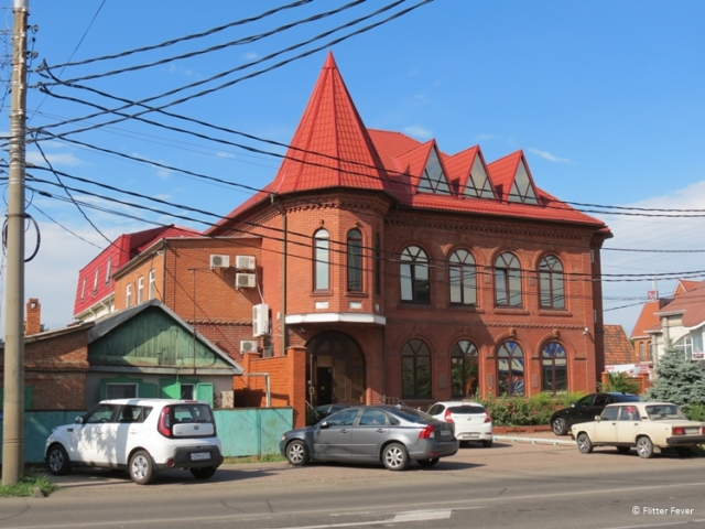 House with red bricks and roof tiles in Krasnodar