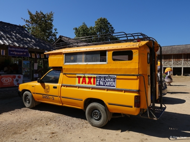 Pai yellow songthaew style taxi from White Buddha to Pai Canyon