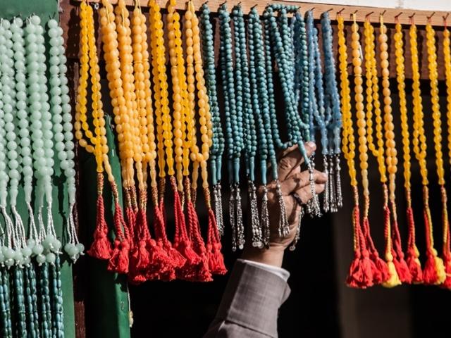Man touching prayer beads in Al Janadriyah, Riyadh, Saudi Arabia