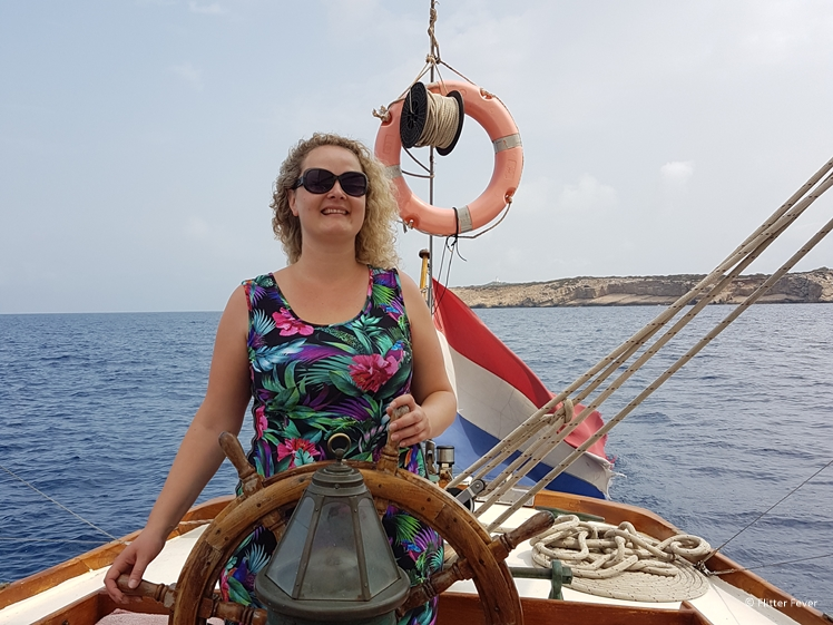 Playing skipper on a sailing boat near the coast of Ibiza