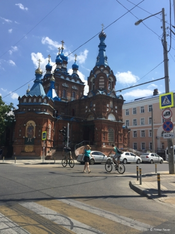 Pretty Russian building with blue roof tiles and red bricks in Krasnodar