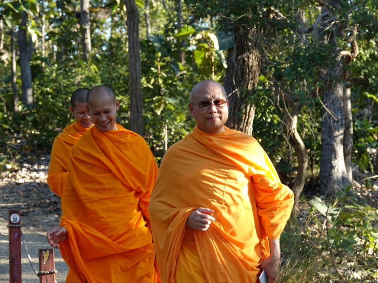 Thai monks in orange robes near Pai Canyon