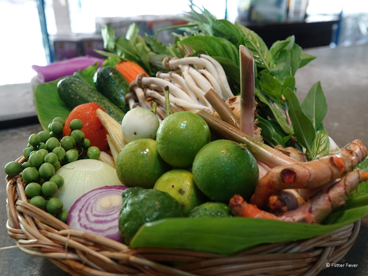 Basket filled with veggies and spices for the Thai cooking class
