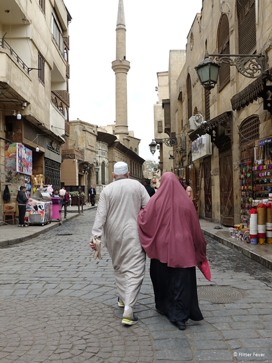 Older couple walking the streets of Historic Cairo