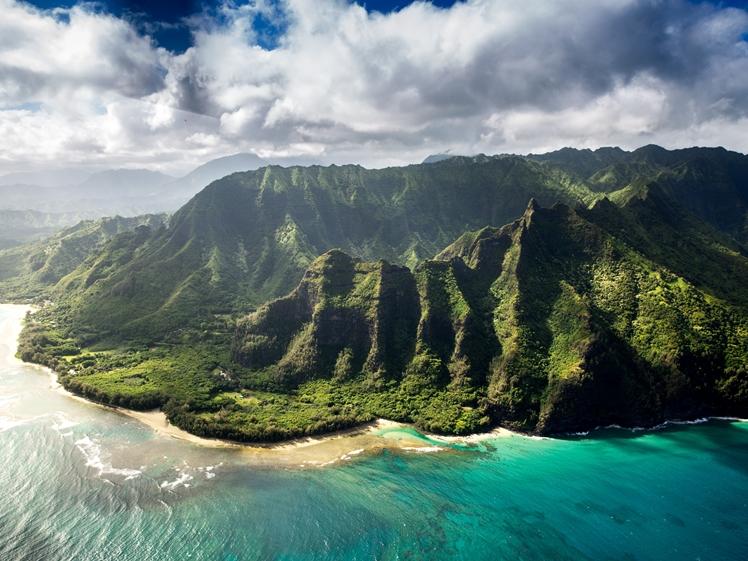 Kauai mountains on Hawaii seen with drone from sea