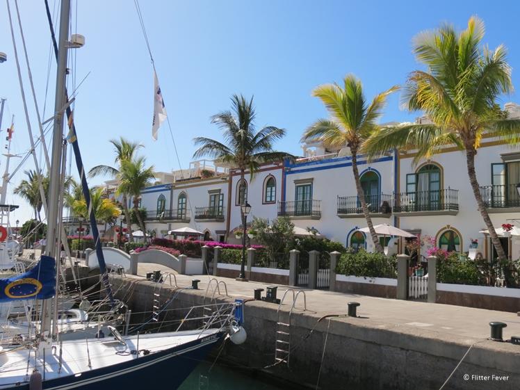 Palm trees and boats in Puerto de Mogan Gran Canaria