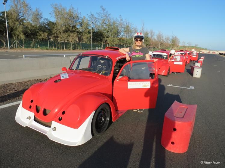 Woman with red VW Beetle racing car at Circuito Maspalomas
