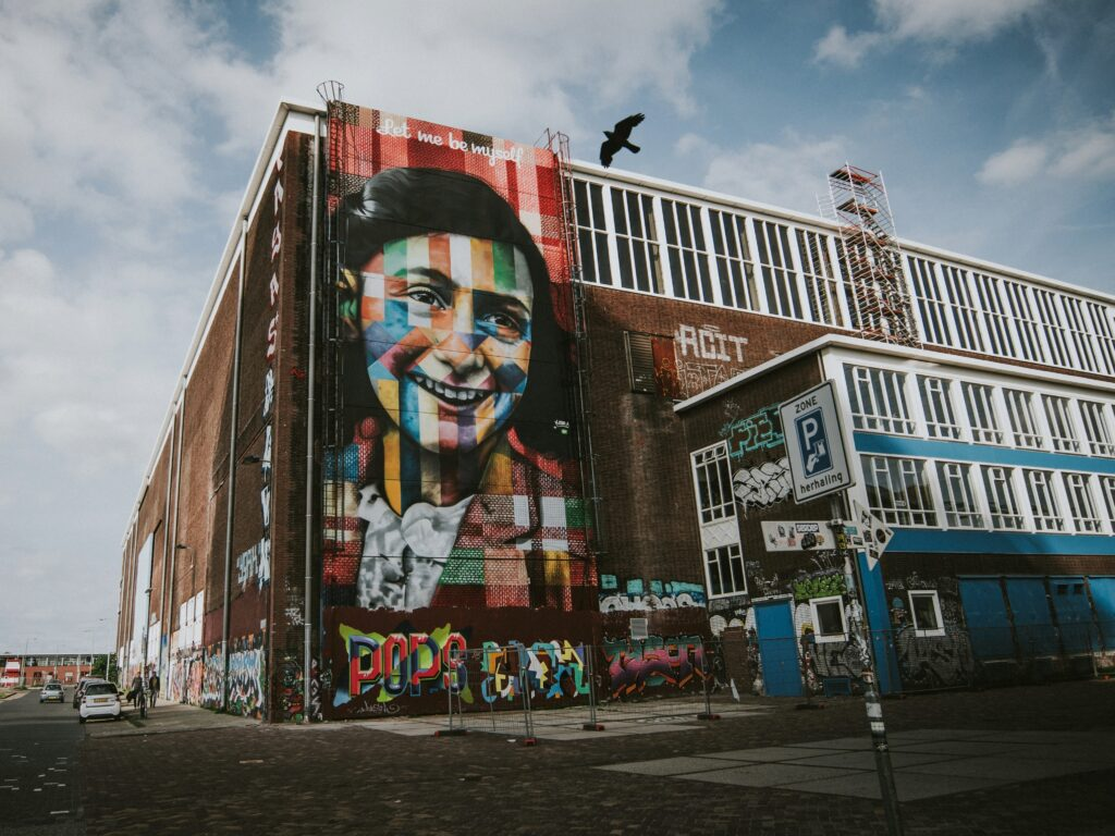Street art of Anne Frank on a wall in Amsterdam