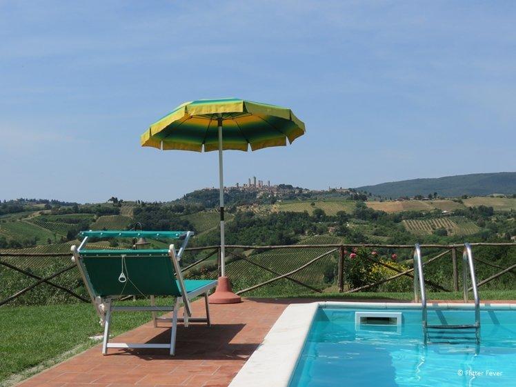 View from swimming pool Fattoria Poggio Alloro Tuscany agritusrimo