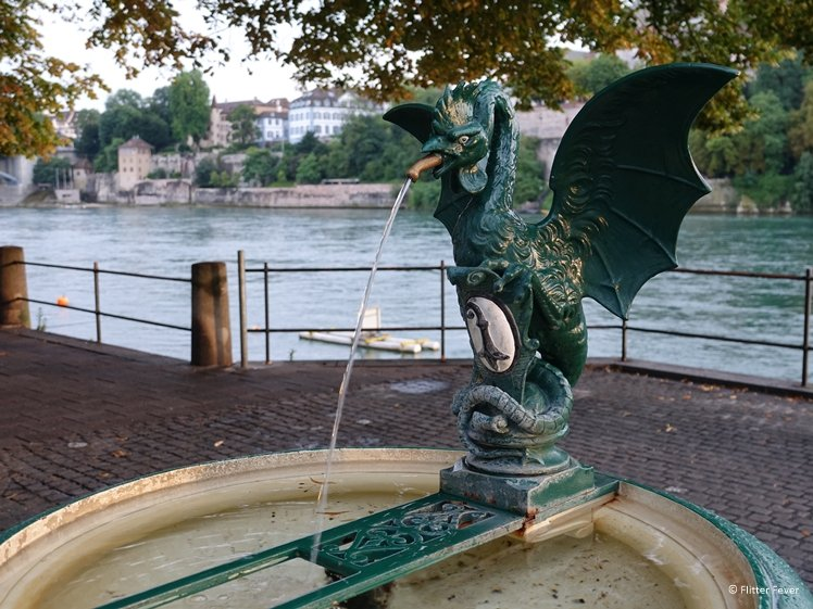 Basilisk fountain dragon holding Basel's coat of arms