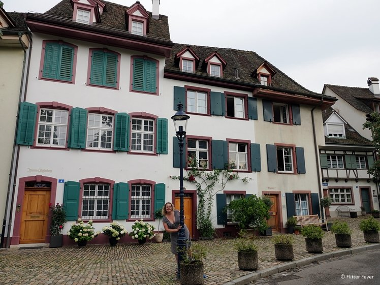Cute houses with green shutters at Petersplatz in Basel
