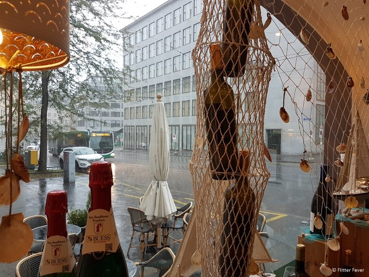 Hiding from the rain with wine at VinOptimum Basel