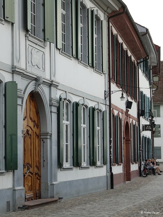 Houses with green shutters at Munsterplatz, Basel