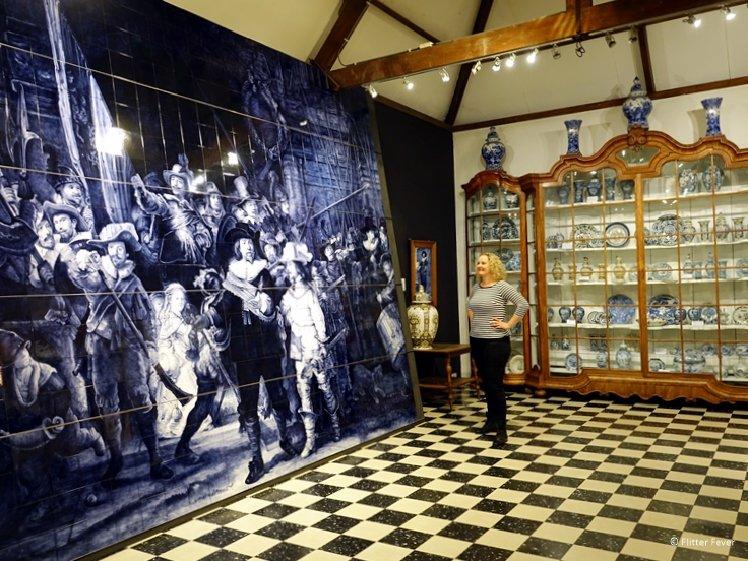 Rembrandts famous painting De Nachtwacht in Delft Blue tiles