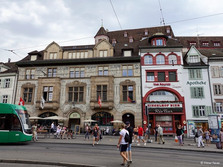 Tram, people and buildings at Barfüsserplatz Basel