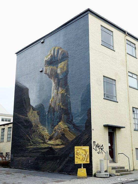 Fist mural Heavy stones fear no weather Reykjavik
