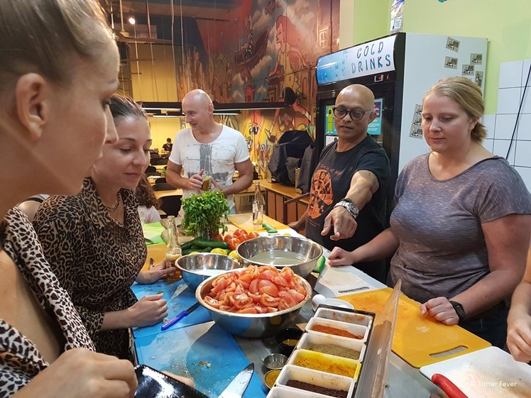 Learning about new spices during cooking class at Abraham Hostel Tel Aviv