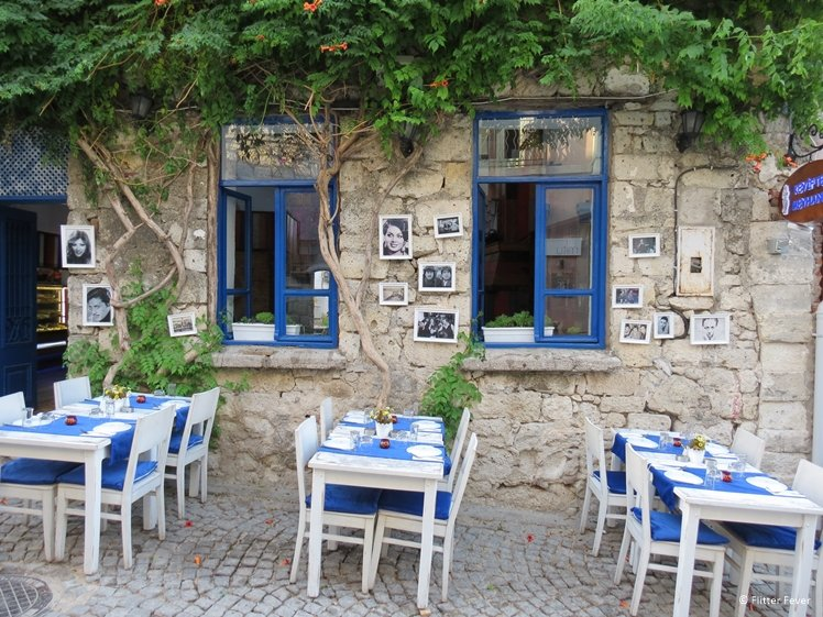 Restaurant seating outside with black and white photos in Alacati