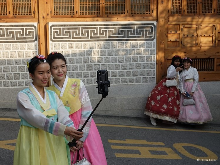 Sweet girls taking selfies in Seoul