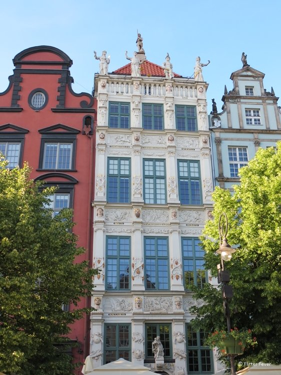 Beautiful detailed architecture of decorated houses in Gdansk