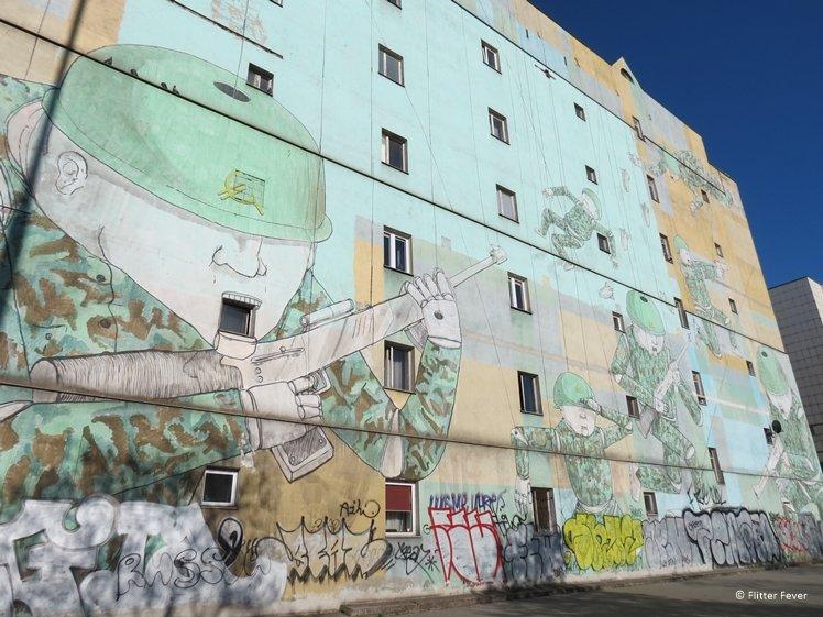 Blu's Mural soldiers at war street art Warsaw