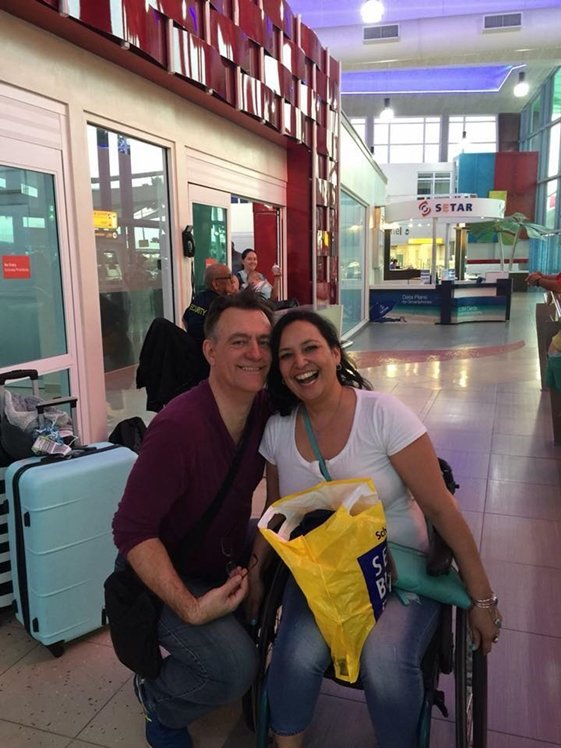 Couple at airport woman in wheelchair