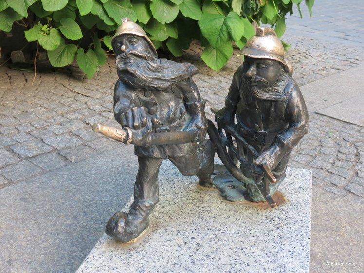 Cute bronze firemen gnomes in Wroclaw