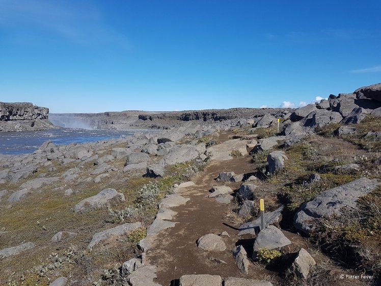 path with yellow posts between Dettifoss and Selfoss waterfalls