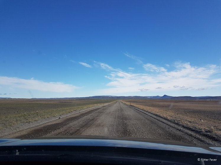 Gravel road on Iceland with clear blue sky