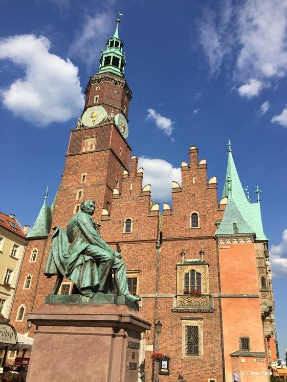Statue poet Aleksander Fredro and St. Elizabeth Church at Rynek Wroclaw