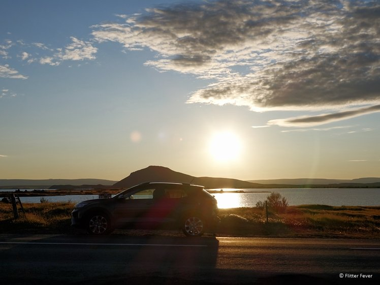 Sunset at Lake Myvatn with car in front