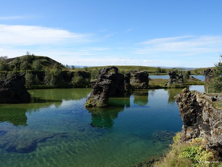 Lava formations sticking out of Lake Myvatn seen from Hofdi Iceland