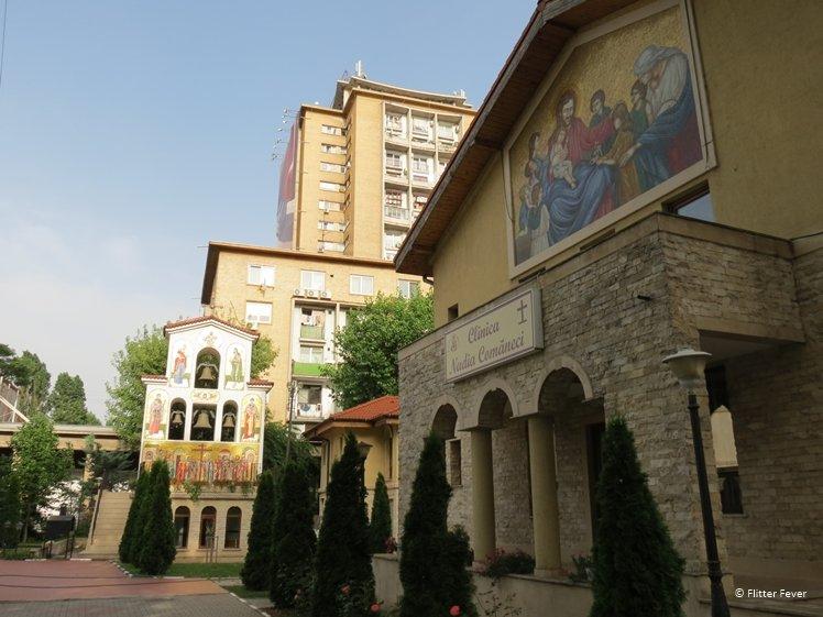 Ugly block flats behind orthodox church in Bucharest