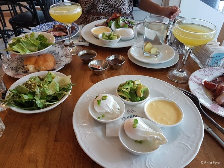 Brunch with poached eggs and avocado at Benedict Tel Aviv