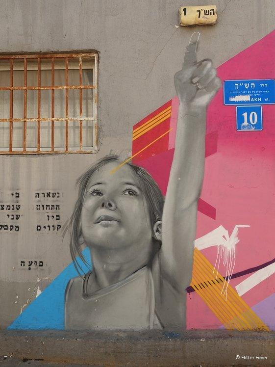 Girl raises her hand street art Tel Aviv
