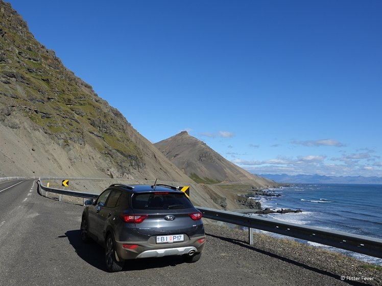 Car with mountain and sea landscape on background