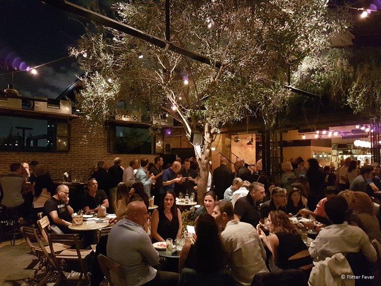 Olive tree at Suramare Tel Aviv rooftop bar